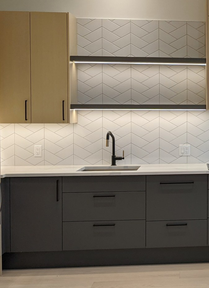 Sink area with floating shelves above