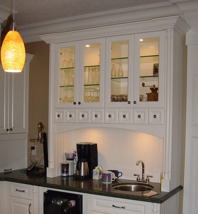glass doors and apothecary drawers