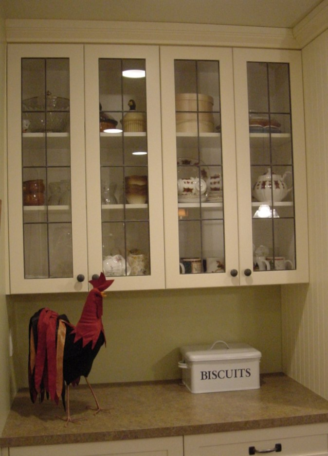 white cabinets with lead glass doors