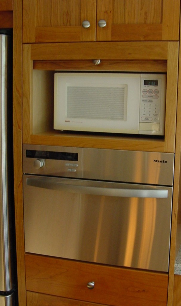 white microwave behind tambour