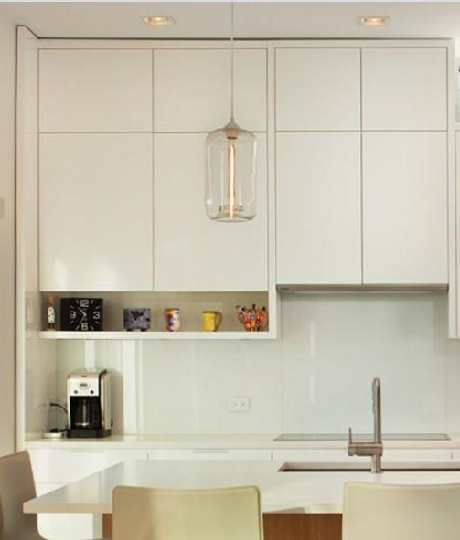 small open shelf below wall cabinets