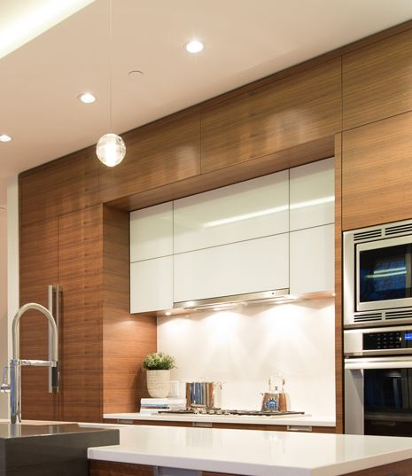 Wood grain cabinets stacked above Gloss white cabinets
