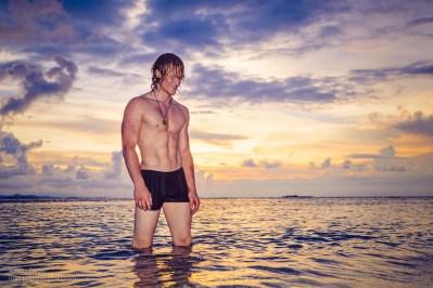 Muscular circus performer models swimwear