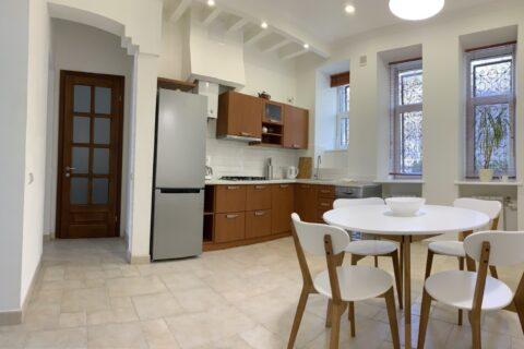 white kitchen with wooden lockers