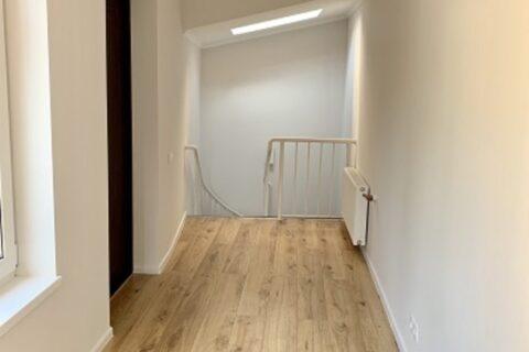 white corridor with wooden floor
