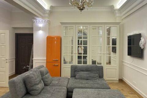 fridger and grey sofa