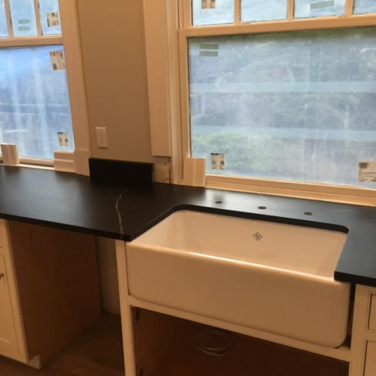 Black counter tops with large windows