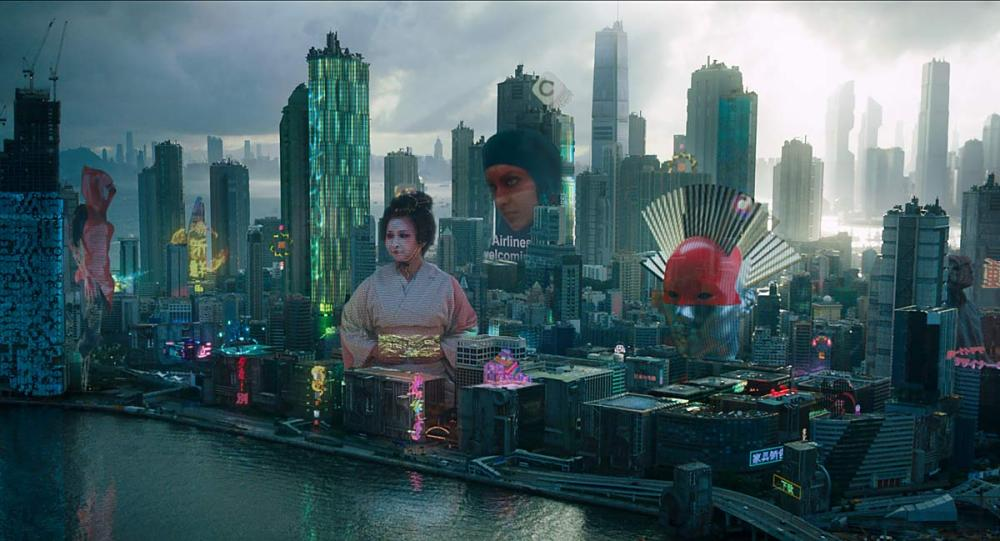 Ghost in the Shell's cityscape. Director Sanders sought to populate the city views with a form of solid, sometimes enormous, augmented reality holograms he called 'solograms'.