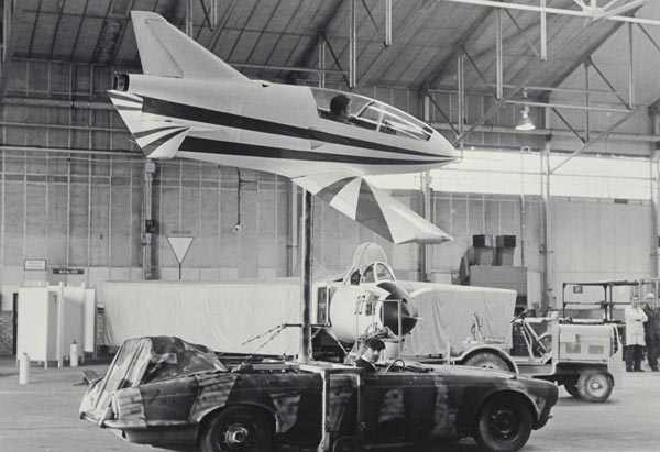 Richardson driving a Jaguar car with a Polearm mounted in the middle. The Bede Jet could bank from side to side controlled by an air-pressurized hydraulic rig. Richardson was able to drive through the hangar at about 75 mph for the opening sequence of Octopussy. The plane flying into and exiting the hangar was filmed with FG miniatures in front of the real hangar. Richardson says that with Bond films he and his team tried to do as much as possible in camera.