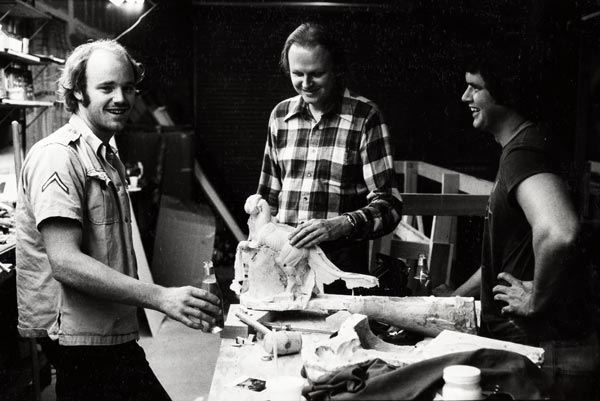 From left, Phil Tippett, Dennis Muren ASC, VES, and Tom St. Amand pose with a mold of a stop-motion Tauntaun during production on The Empire Strikes Back.