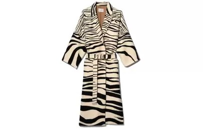 10. The animal-print trench