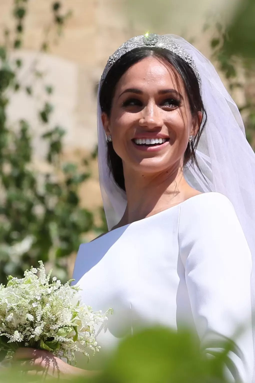 Close up of Meghan Markle's wedding dress and tiara in the sunshine
