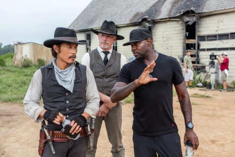 Byung-hun Lee (left) and director Antoine Fuqua (right) on the set of Metro-Goldwyn-Mayer Pictures and Columbia Pictures' THE MAGNIFICENT SEVEN.