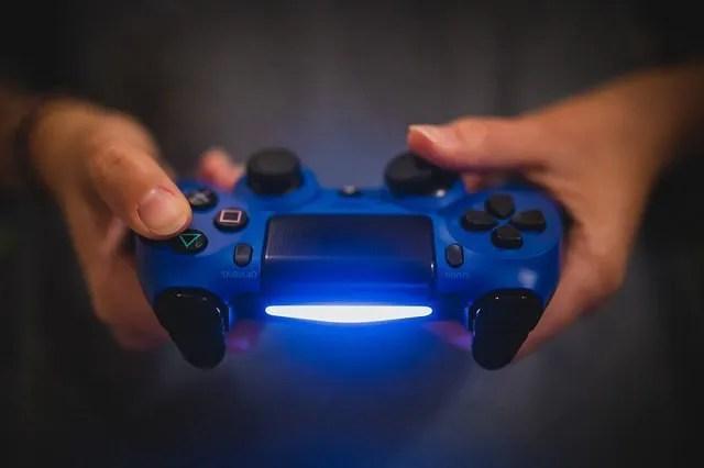 Holding a Sony Playstation 4 Dualshock Controller Light Bar