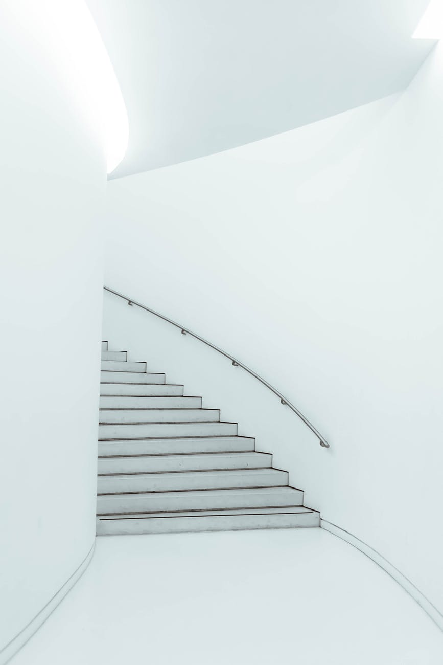 staircase with railing in modern white building