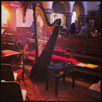 Setting up for a concert with the Stonehaven Chorus, with the setting sun streaming through the church windows