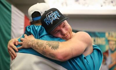 Canelo hugs coach