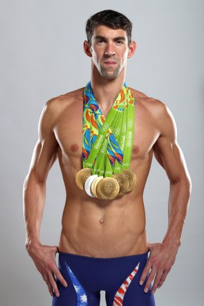 RIO DE JANEIRO, BRAZIL - AUGUST 16: (EXCLUSIVE COVERAGE, MINIMUM FEES APPLY) Swimmer Michael Phelps of the United States poses for a portrait on August 16, 2016 in Rio de Janeiro, Brazil. Phelps, the most decorated Olympian in history, won five gold medals and one silver in Rio. He has 23 gold medals in his career. (Photo by Al Bello/Getty Images for Octagon)
