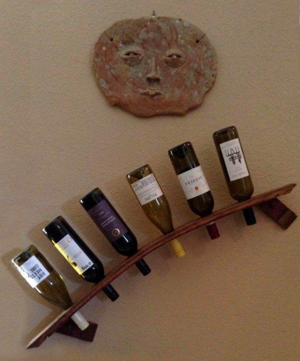 porta vinhos inclinado parede