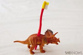 dinossauro porta escova de dente