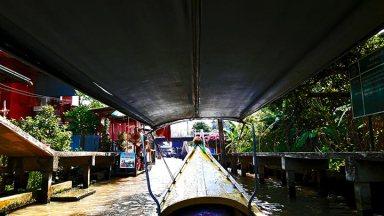 Long tail boat canal río mercado flotante