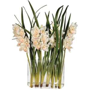 Cream orchids and leaves in glass vase