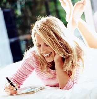 10 Apr 2001 --- Happy woman writing --- Image by © Thomas Schweizer/CORBIS