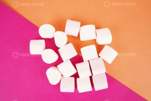 Marshmallows on multicolored background stock photo