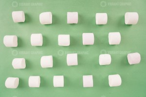 Pattern with marshmallow candies on green stock photo