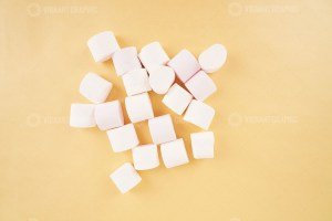White marshmallow on yellow stock photo