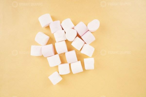 White marshmallow on yellow stock photo