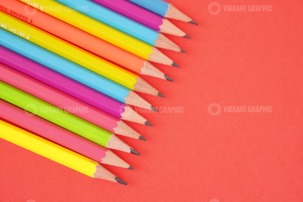 Color pencils on red stock photo