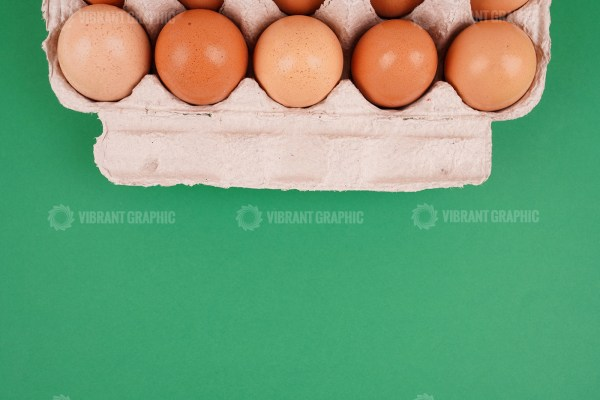 Eggs in a tray on green