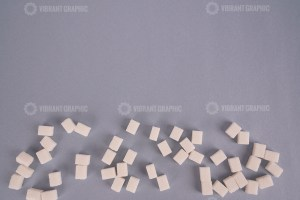 Lump sugar on grey stock photo