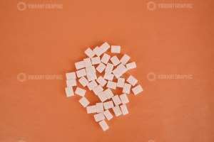 Sugar cubes on orange background stock photo