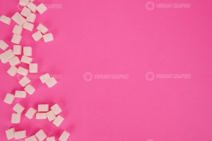 Sugar cubes on pink background stock photo