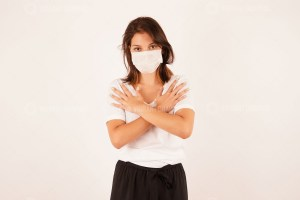 Girl in medical mask with crossed arms