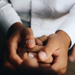 Photo of couple holding hands closeup