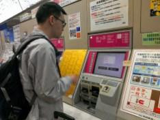 Jacky buying PASMO at the machine