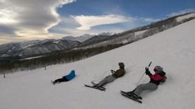 Ski Trip Jan 2015 D5: Friends Lounging in the Snow