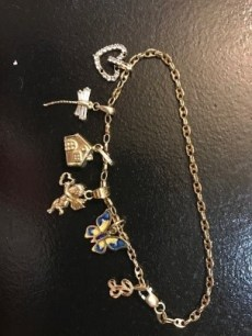 Inspirational messages and signs from departed loved ones. Charm bracelet symbolizing the Independence home built for Ben