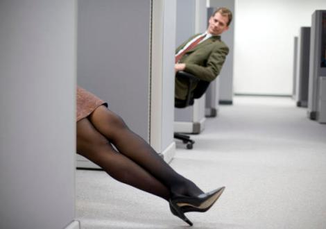she uses her sexy legs to tease coworkers at the office