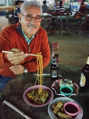 Deig relishing his night market noodles