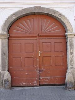 Empire motifs surround this door