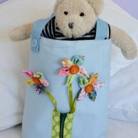 Create a fun busy toddler bag with fabric scraps