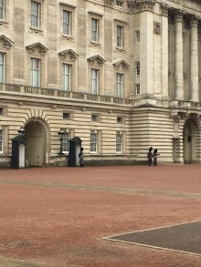 Two Guards marching along Buckingham Palace for changing of their duty
