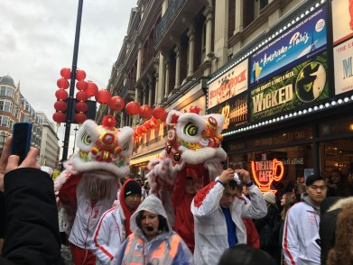 Chinese dragons dancing through th crowds