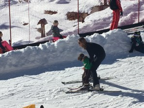 My host mother shows L the joy of skiing