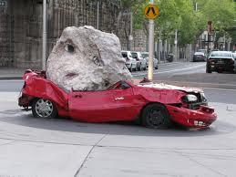 Rock crushes car
