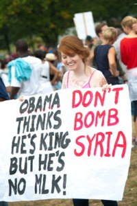 A sign displays a message about Syria at the commemoration of the 50th anniversary of the March on Washington August 28, 2013, in Washington, D.C. (Rena Schild / Shutterstock.com)